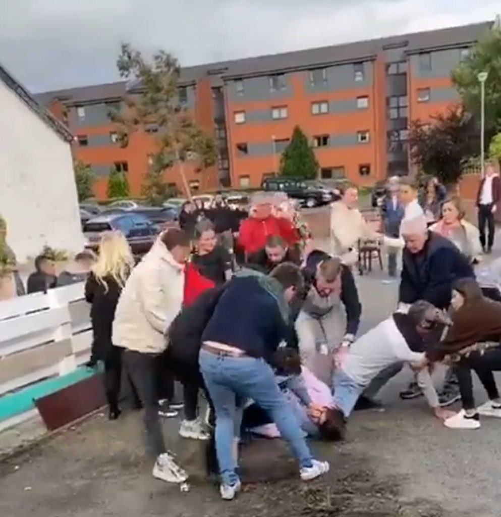 A mass brawl taking place outside a pub the first day that beer gardens opened