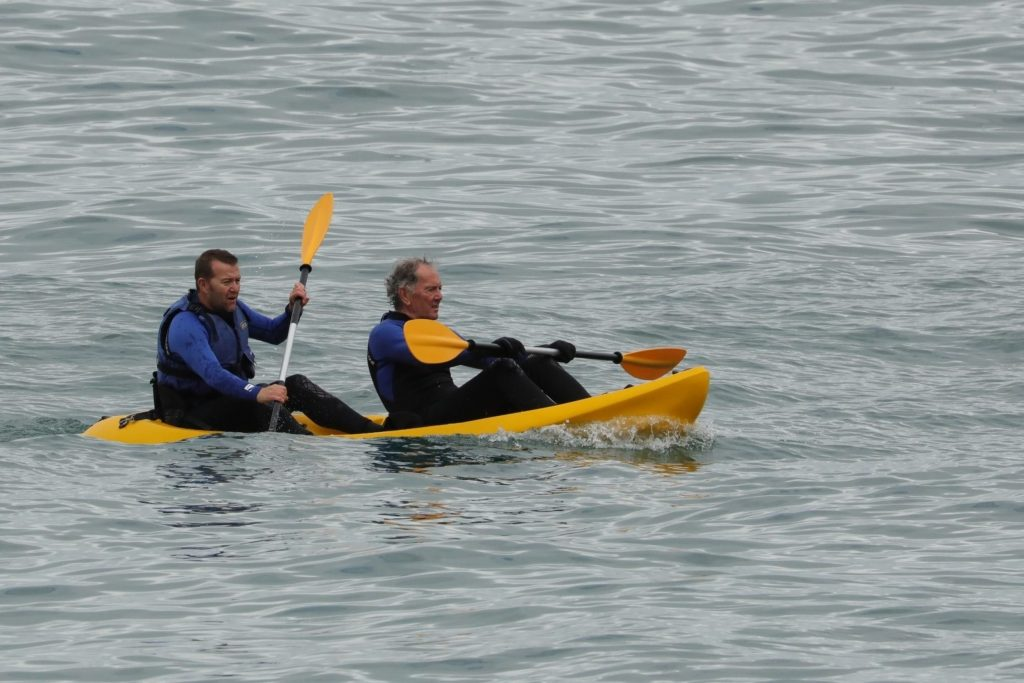 Mark (l) and Eddie (r) watched the dolphin breach the water just metres from their kayak (C) Steve Truluck