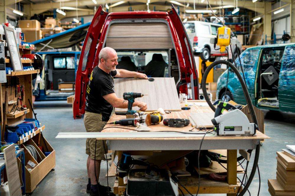 Ian Adkins working on VW campervan conversion. Business News Scotland
