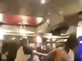 A picture of a fight inside a Wetherspoons