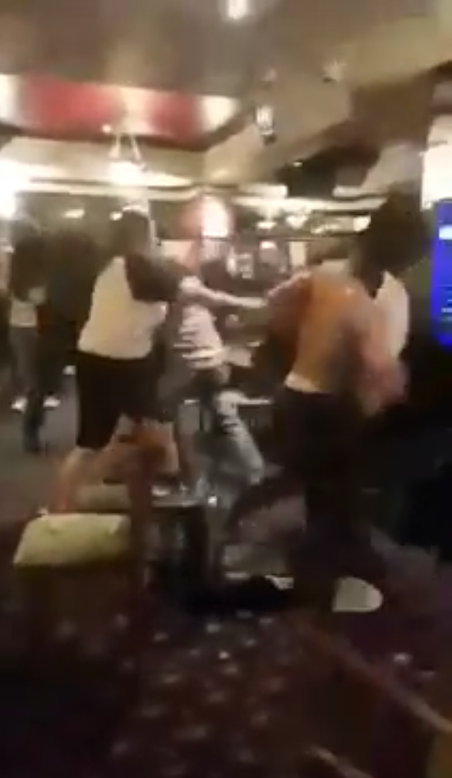 One man can be seen with his shirt taken off as the chaos continues- Deadline News