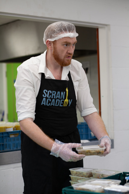 A man working for Scran Academy Business News Scotland