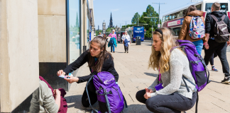 Two women helping a homeless person Deadline News Business News Scotland