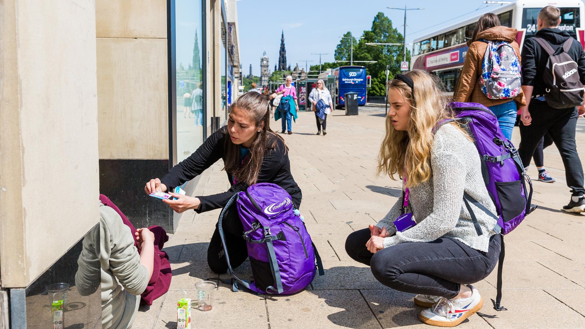 Two women helping a homeless person Deadline News Business News Scotland