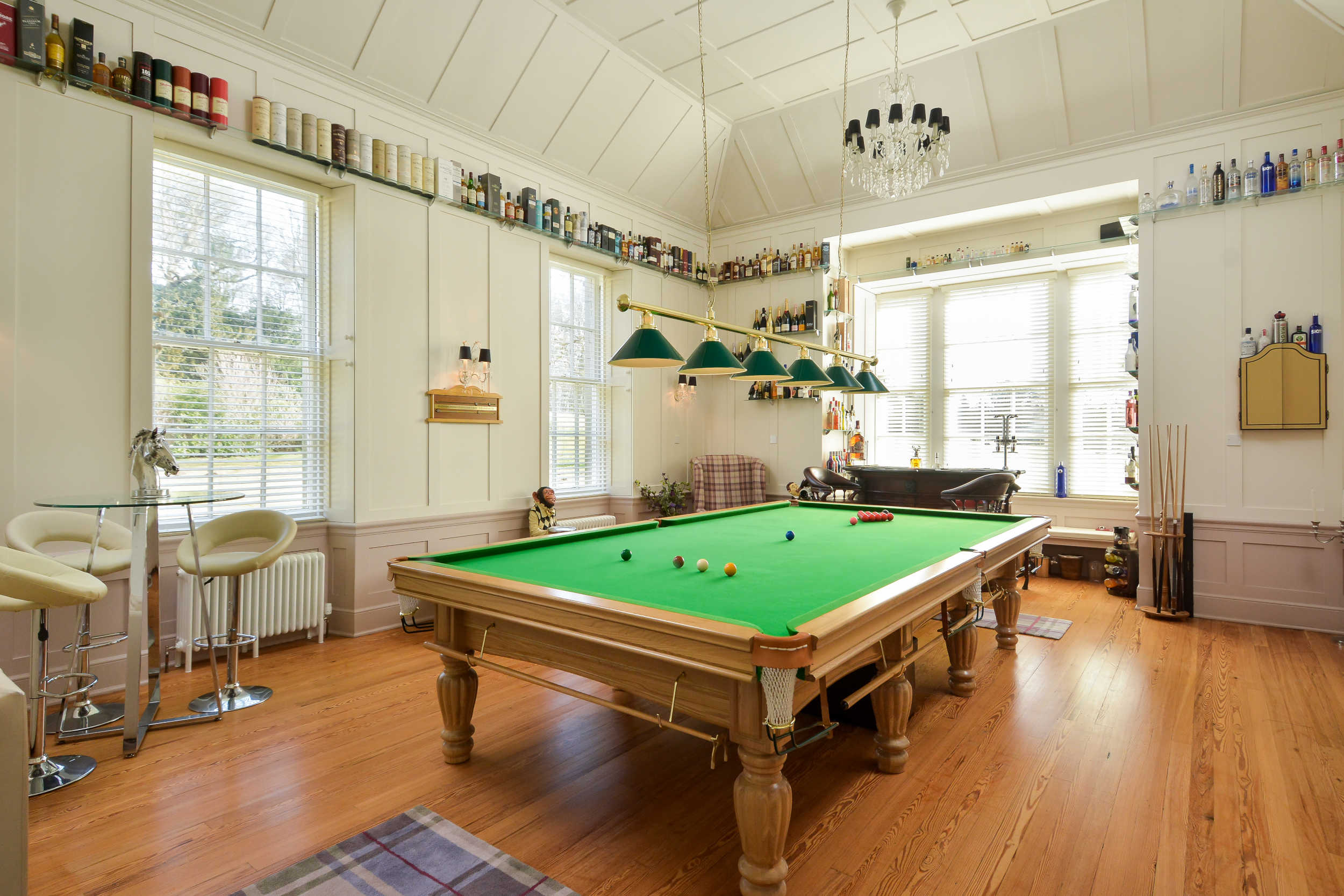 Straloch house interior, pictured a pool table inside the elegant dining room