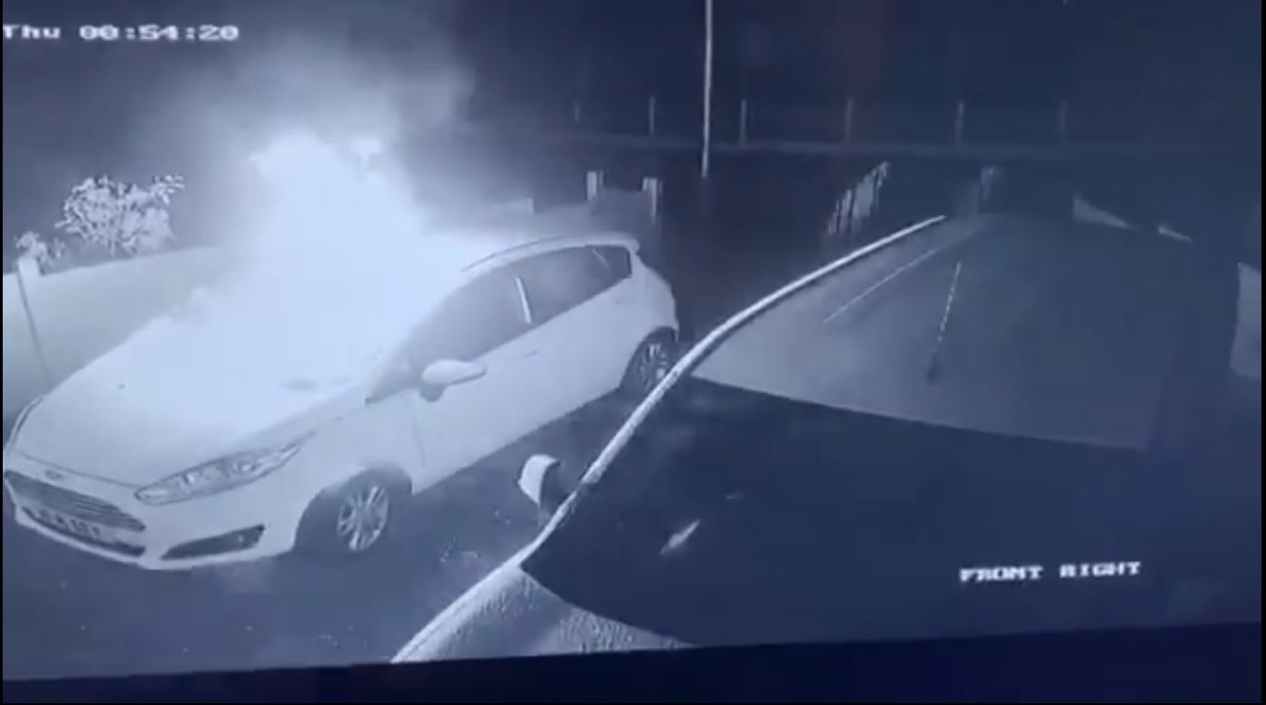 Yobs flee from the scene after setting the car on fire