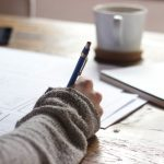 Woman writing essay
