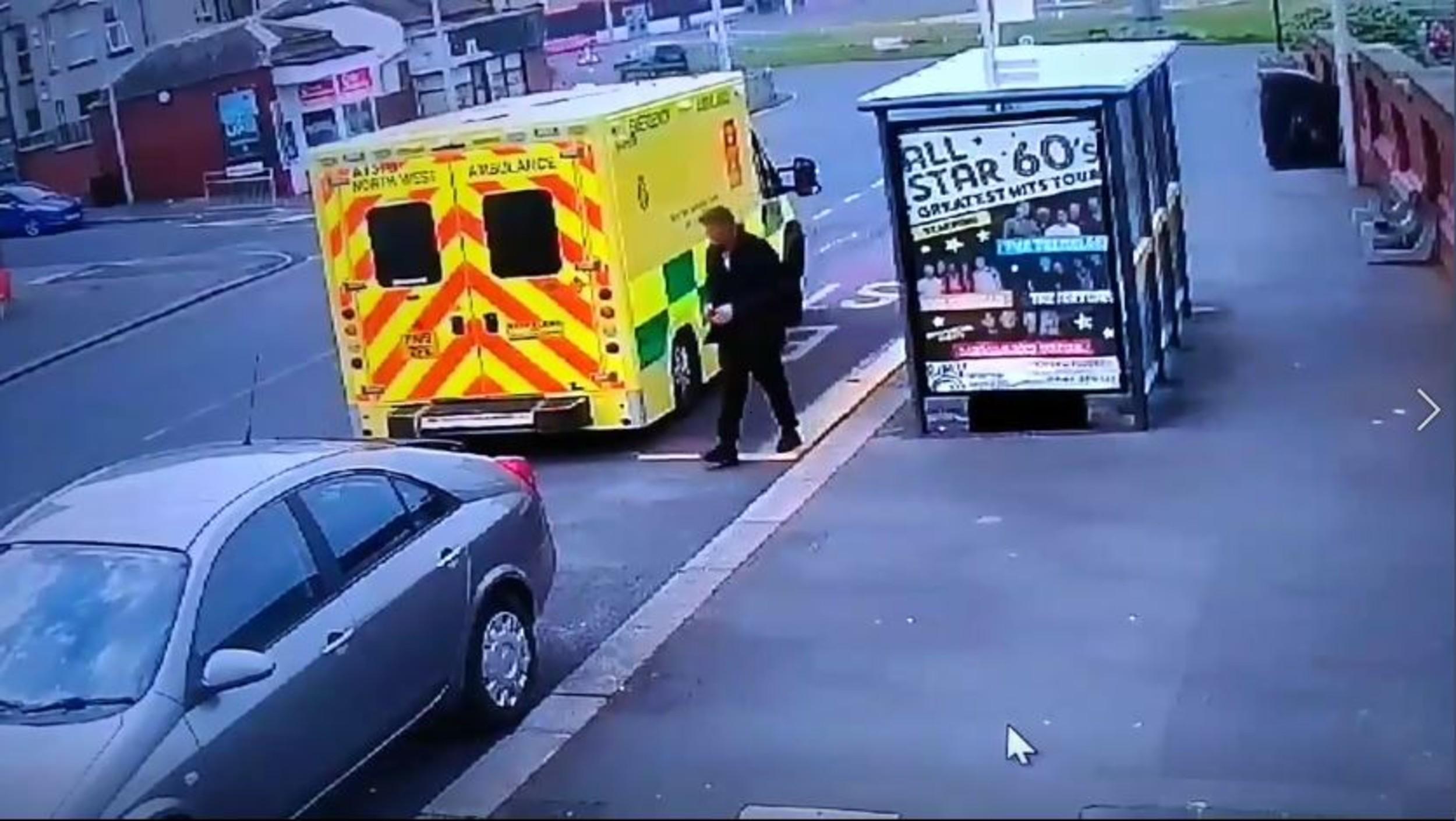 A man wandering outside an ambulance| By Deadline News, Viral Video News