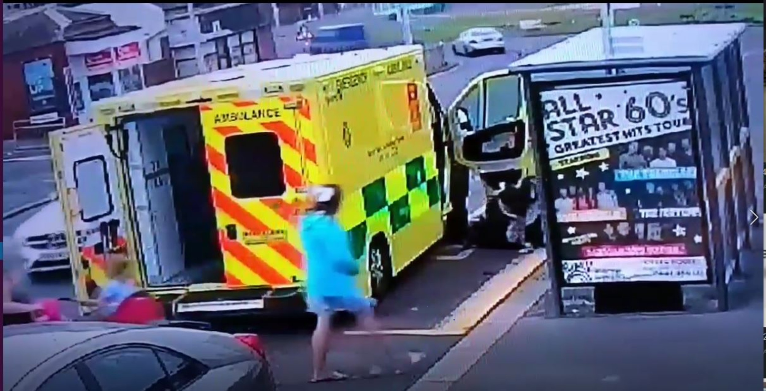 Two paramedics apprehend the man while a family walks by| By Deadline News, Viral Video News