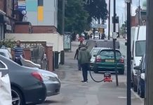 Man vacuuming street Coventry