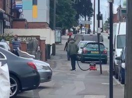 Man vacuuming street Coventry