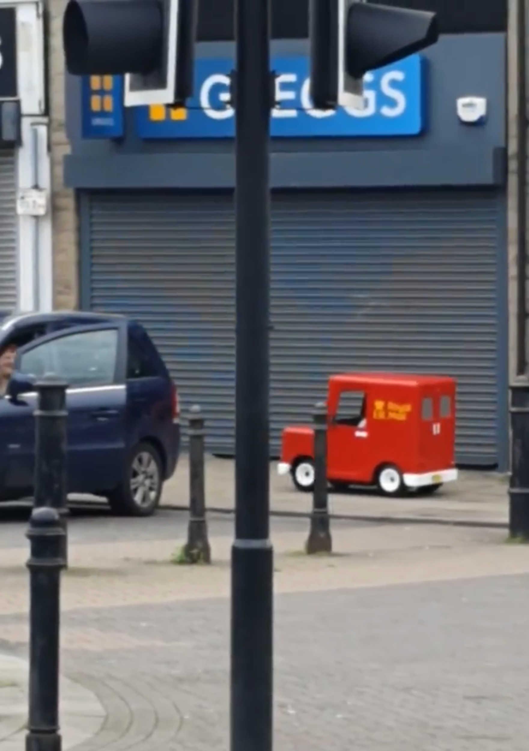 Royal Mail van outside shop