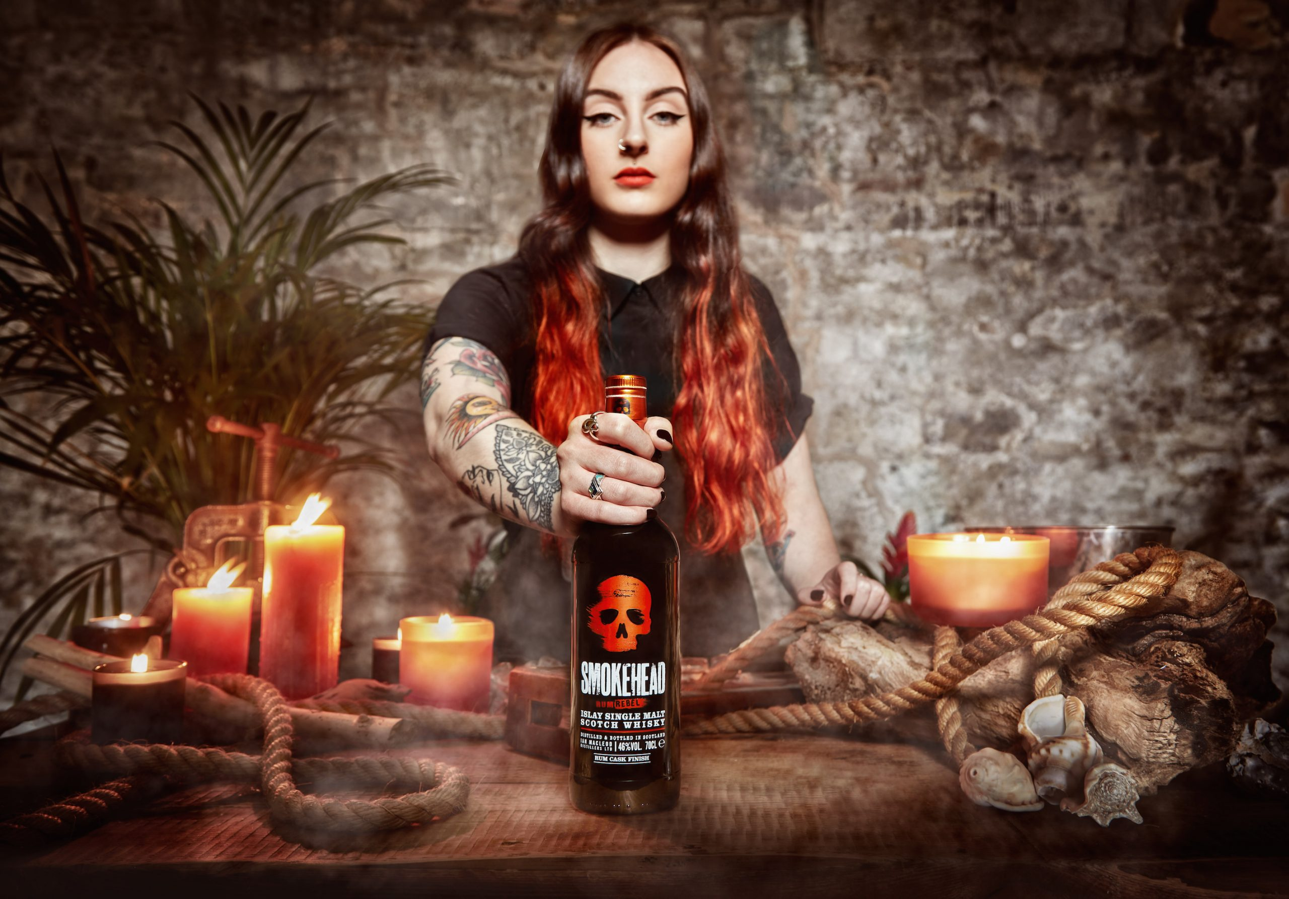 Picture of a woman with Smokeheads latest whisky- Food and Drink News Scotland