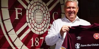 Hearts CEO Andrew McKinlay holds up jersey | Hearts news