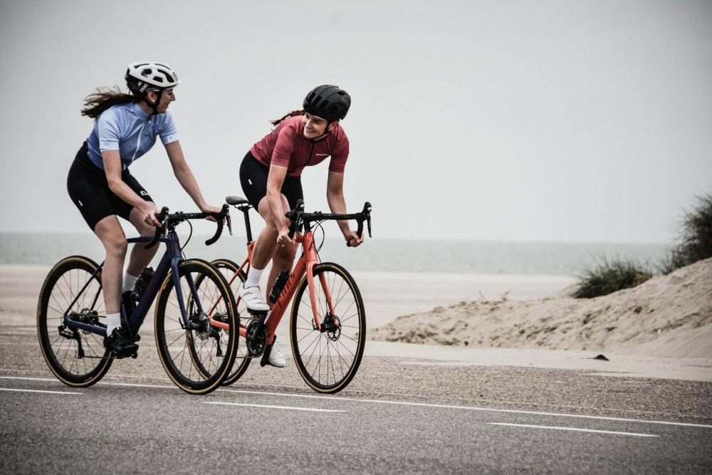 Two women on bikes