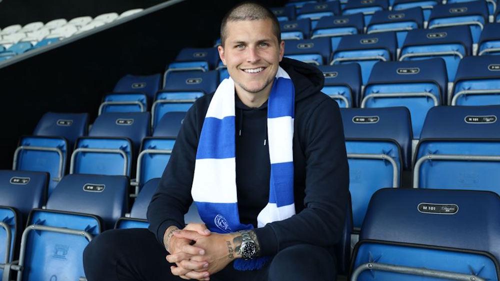 Dykes poses with QPR scarf at Loftus Road | Livingston news