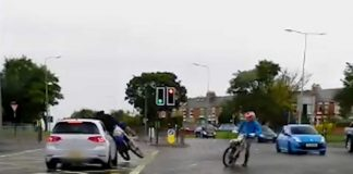 Shocking video captures an idiot biker hitting a car after running a red light