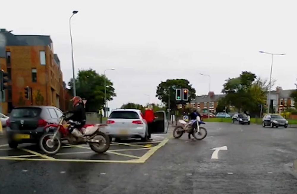 Shocking video captures an idiot biker hitting a car after running a red light