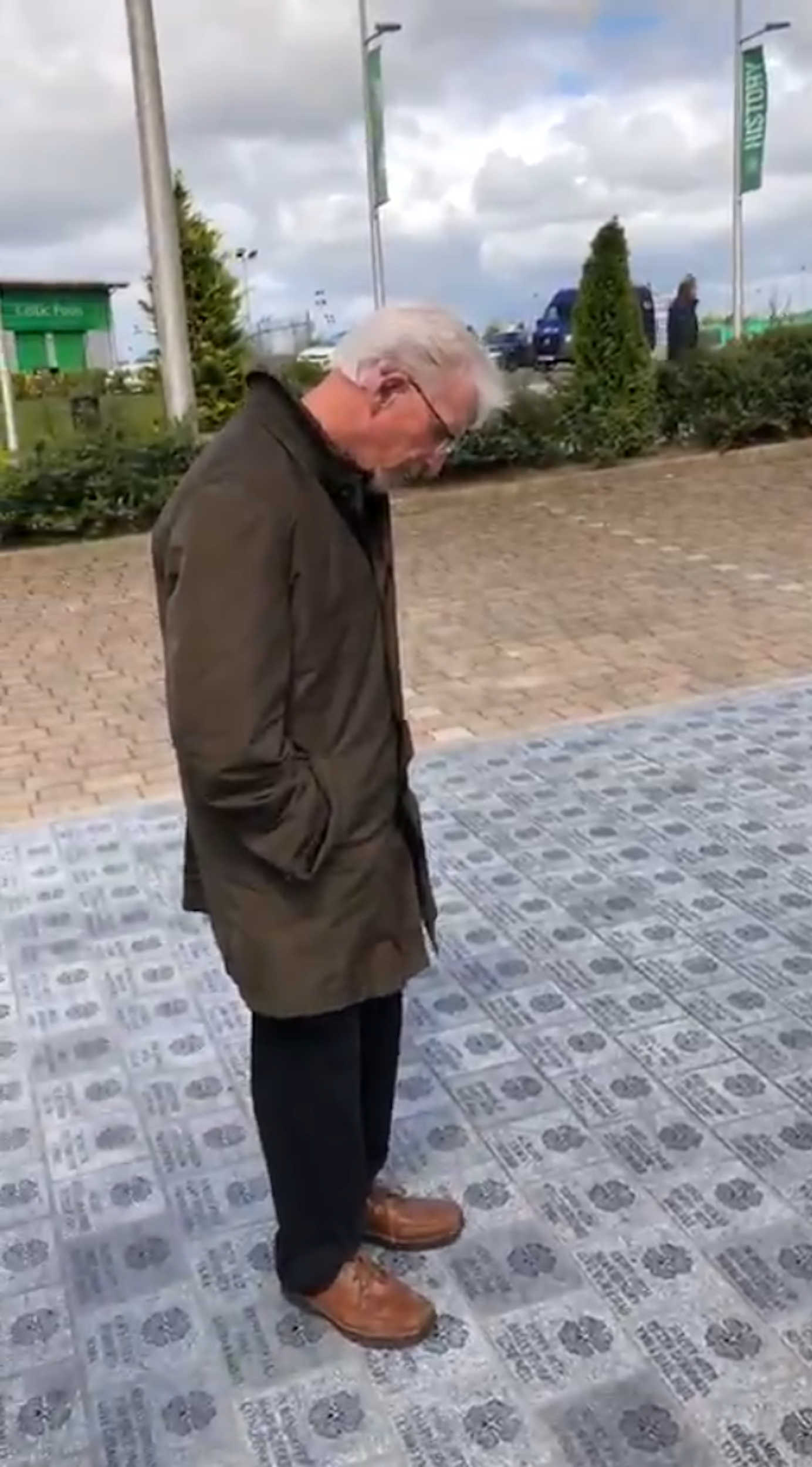 Phillip looking down at his plaque before the emotion overwhelmed him - Scottish News