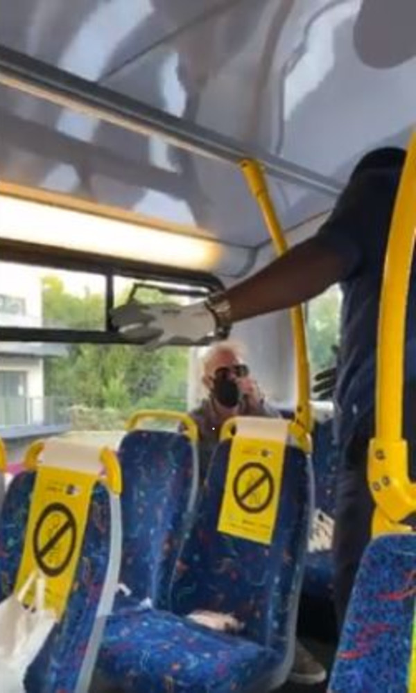 A woman was filmed hurling racist abuse at bus passengers in Dublin