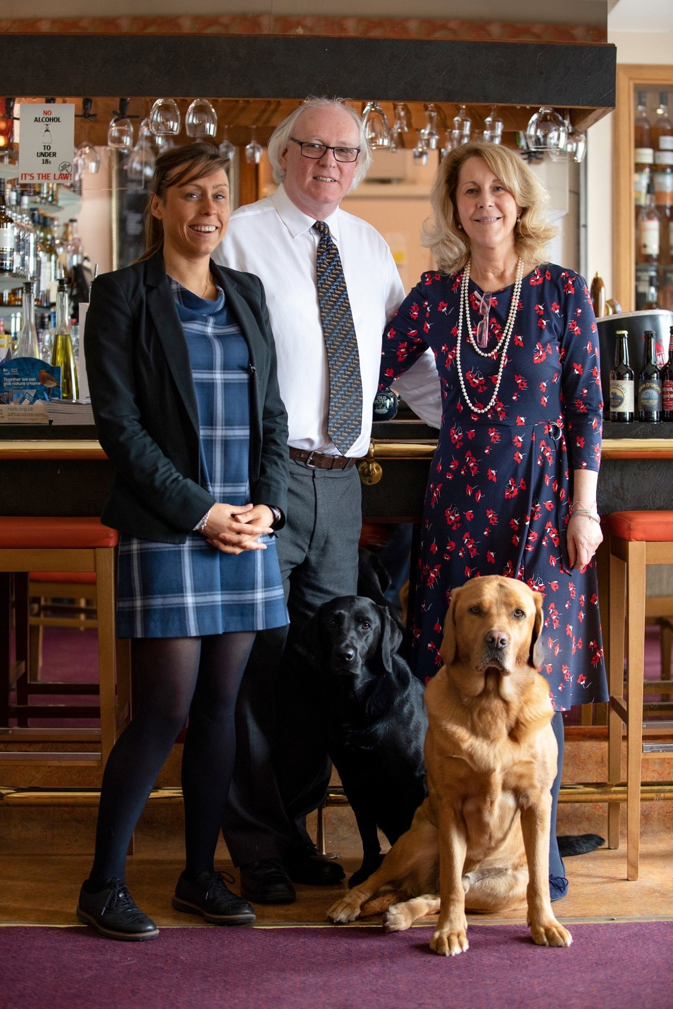 The Lamont family at Mackays Hotel (L-R): Jennifer Lamont, Murray Lamont, Ellie Lamont, plus the Lamont's dogs Bria (black) Max (red).- Business News Scotland