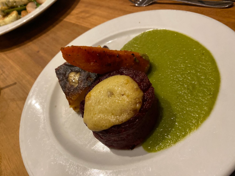 baked beetroot pudding with Bramley Apple and Kintyre Applewood smoked cheese with potato and swede dauphinoise, roasted carrot and served with a pea sauce.- By David Bann restaurant- Food and Drink News Scotland