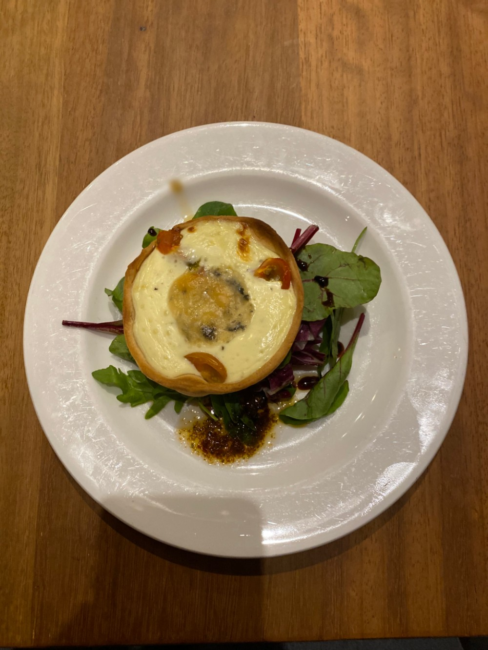 Shortcrust tartlet of blue cheese and cherry tomatoes, by David Bann restaurant