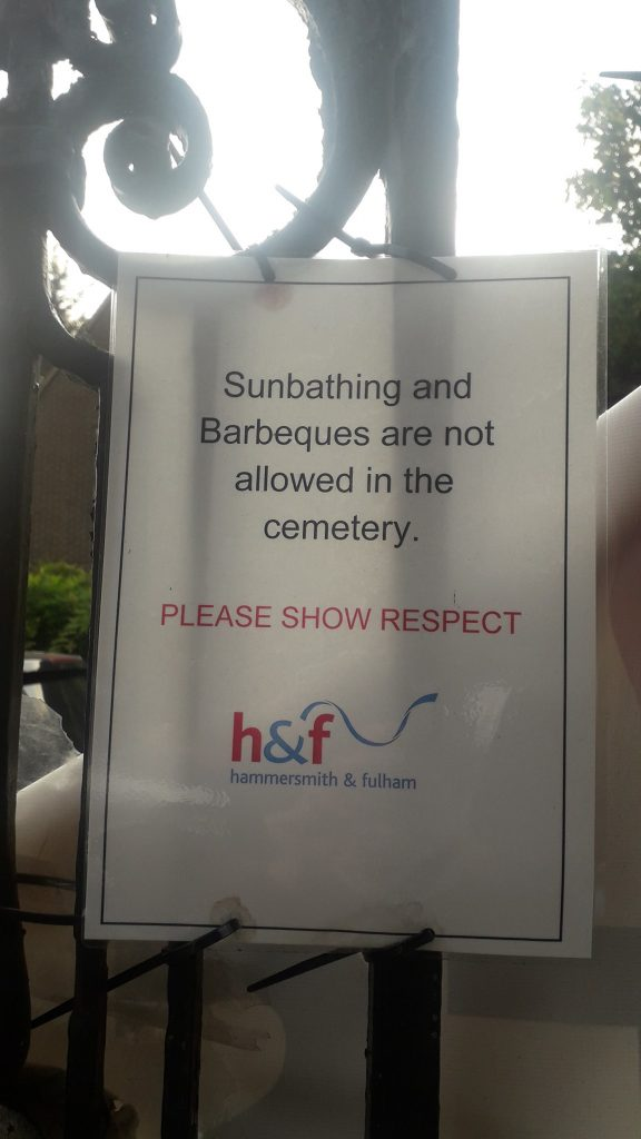 """VISITORS at a cemetery have been left baffled after a sign appeared forbidding them from """"sunbathing and barbecuing"""" at the graveyard."""