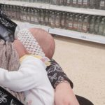 Mum breastfeeding her baby in an aisle in Tesco