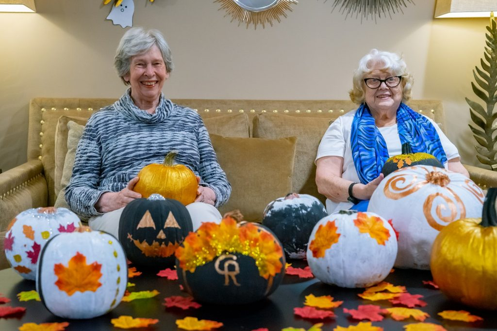 Dawn Ingle and Dorothy McDermott with painted pumpkins 1