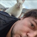 A picture of a man and a rabbit - Viral News UK