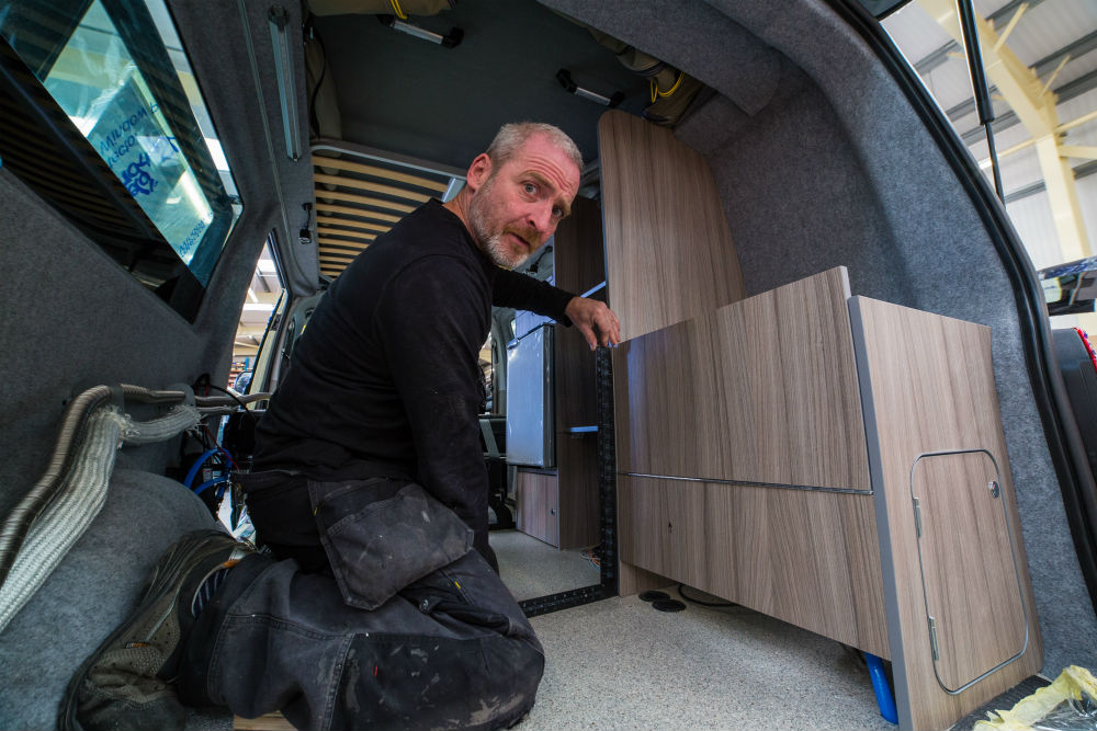 Ian Adkin working on VW campervan conversion. Business News Scotland