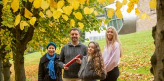 James Homan with his Famil receiving his degree with distinction