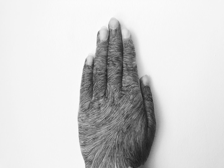 An image of a hand- Art News Scotland