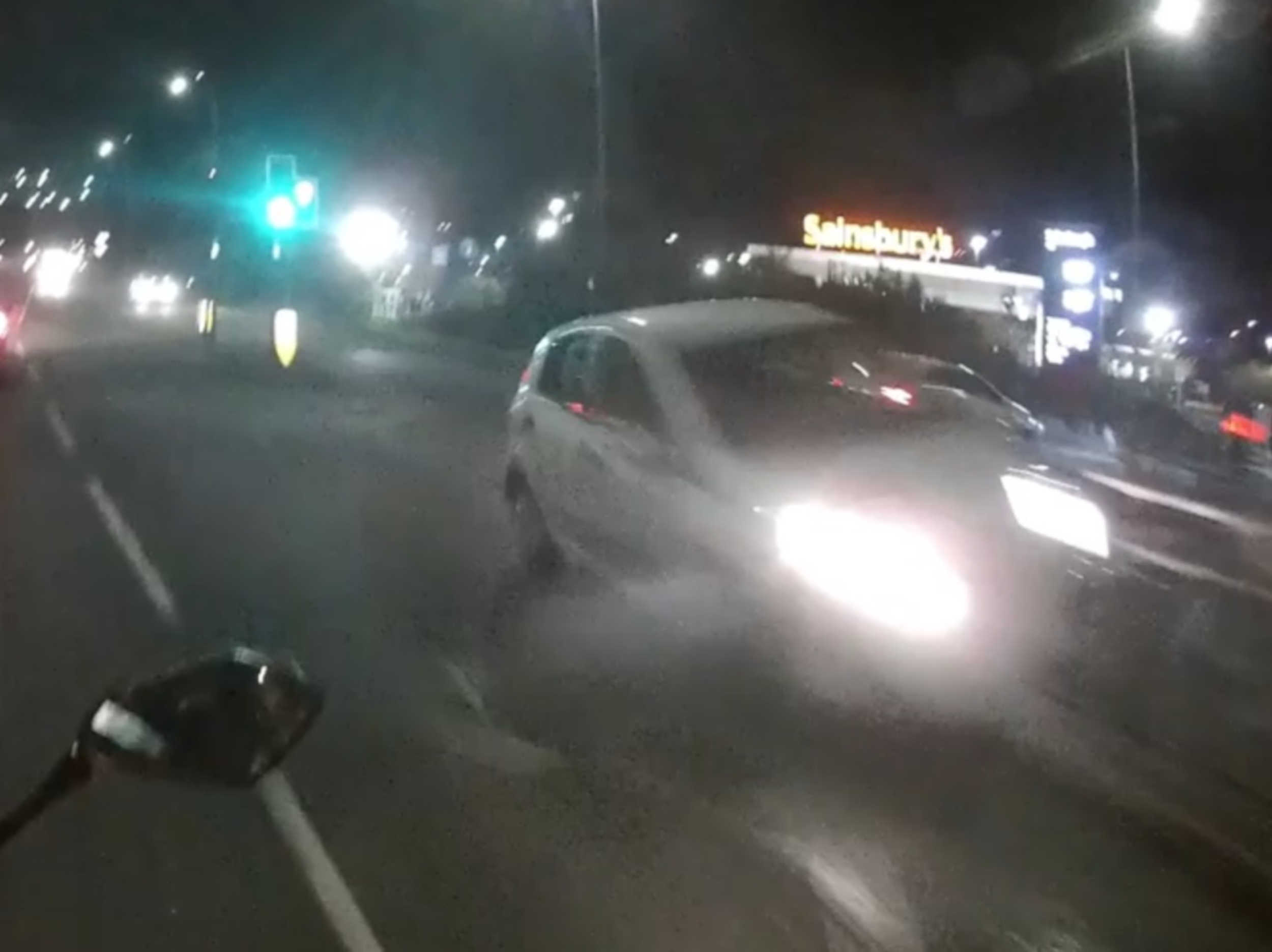 The car narrowly missing the biker- Viral Video News UK