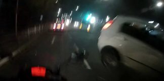 The car narrowly misses the bike - Viral Video News UK