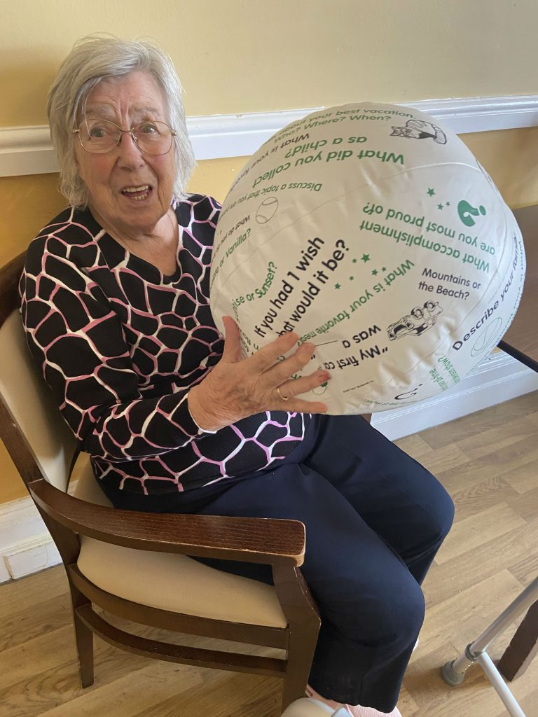 Sadie Fisher at Bellhaven House using a coversation ball - Mansfield Care