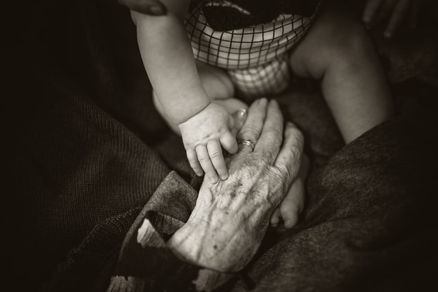 An elderly person and a young persons hands
