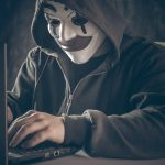 An anonymous hacker using a computer
