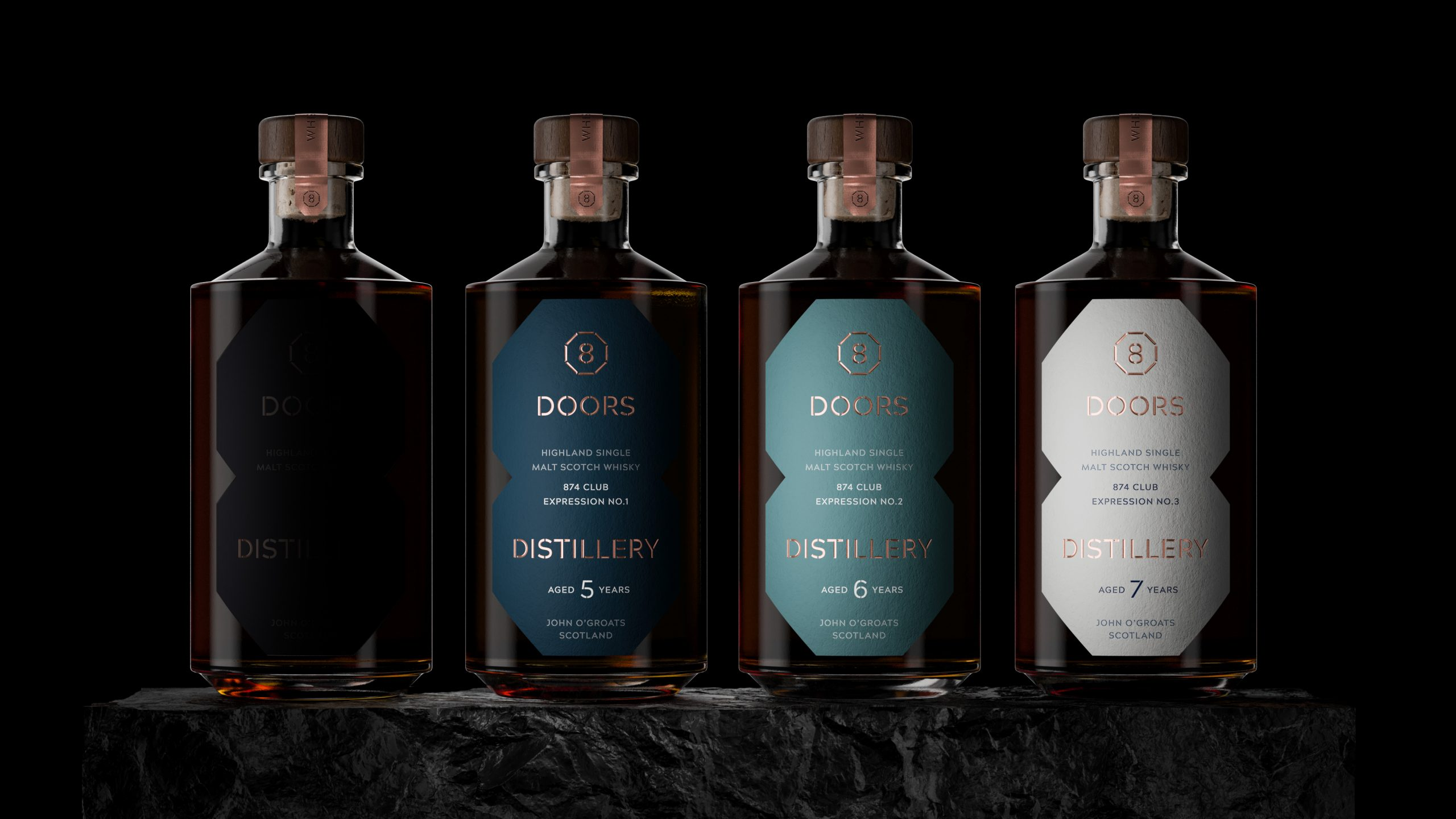 Four whisky bottles from 8 Doors distillery