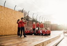 A group of children playing music on an outdoor stage - Entertainment News Scotland