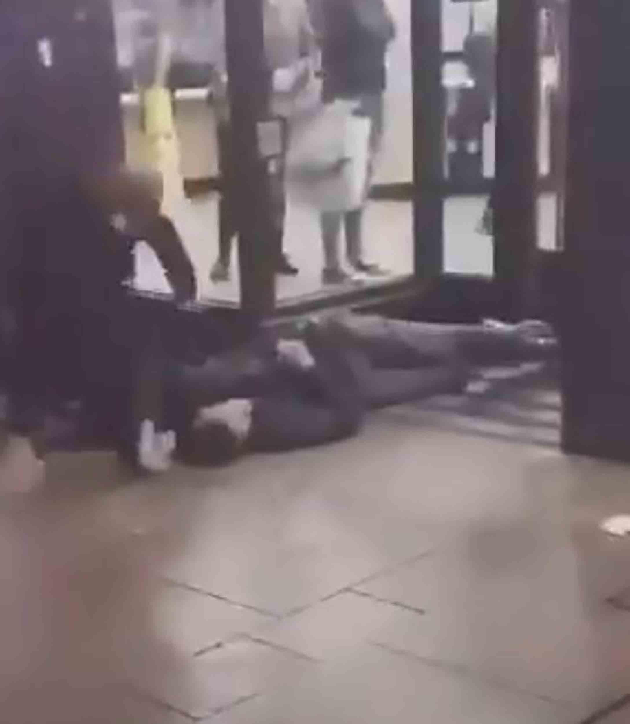 Man on floor outside McDonalds