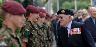A veteran speaking with younger soldiers - Health News Scotland