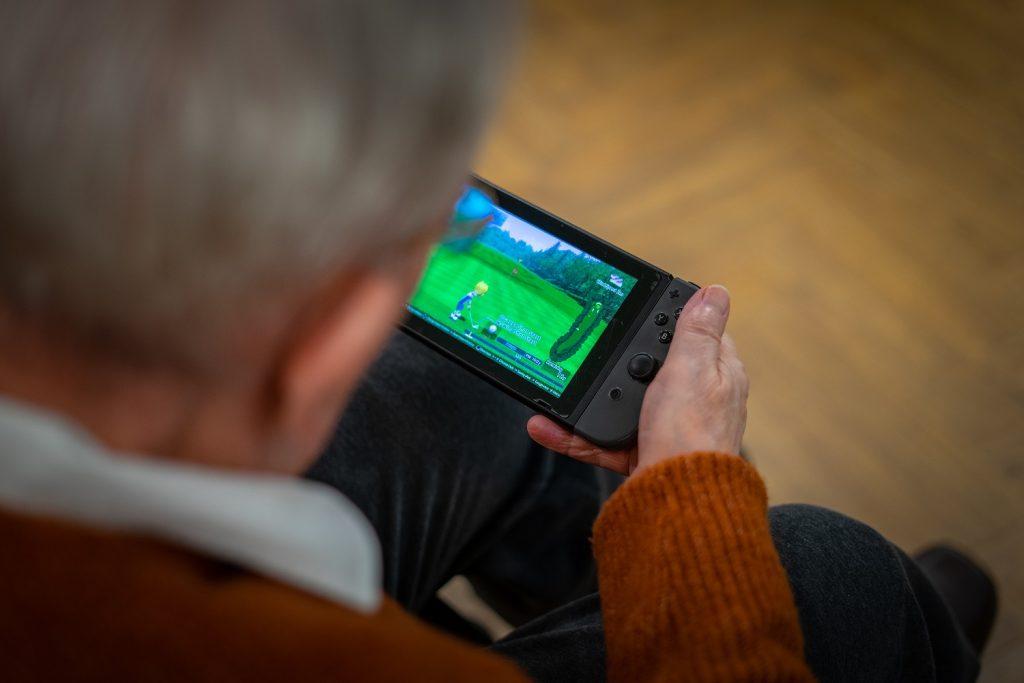 Professor Pompa using Nintendo Switch, Cramond Residence