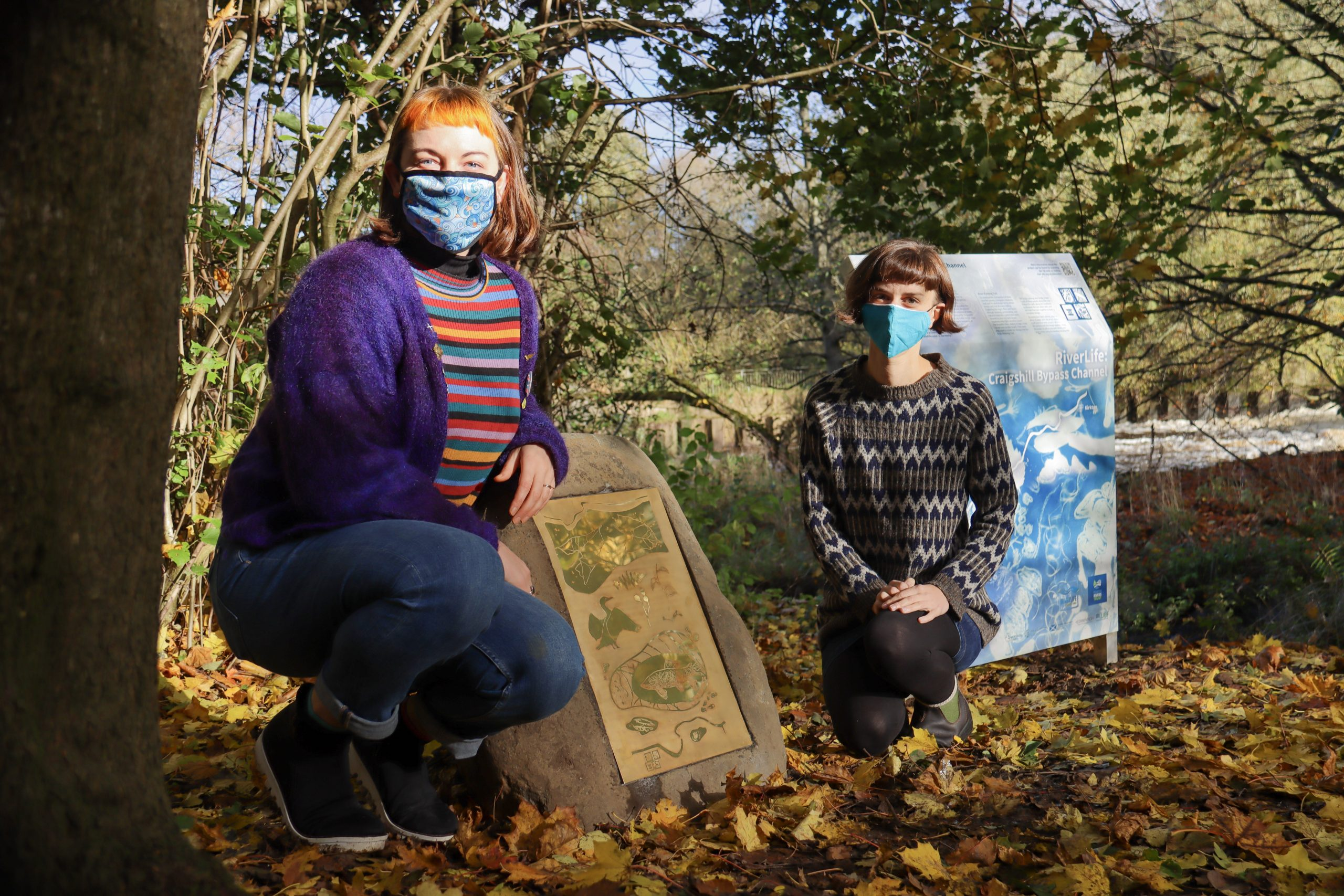 The River Life project two people posing in front of the brass plaque with art - Art News Scotland