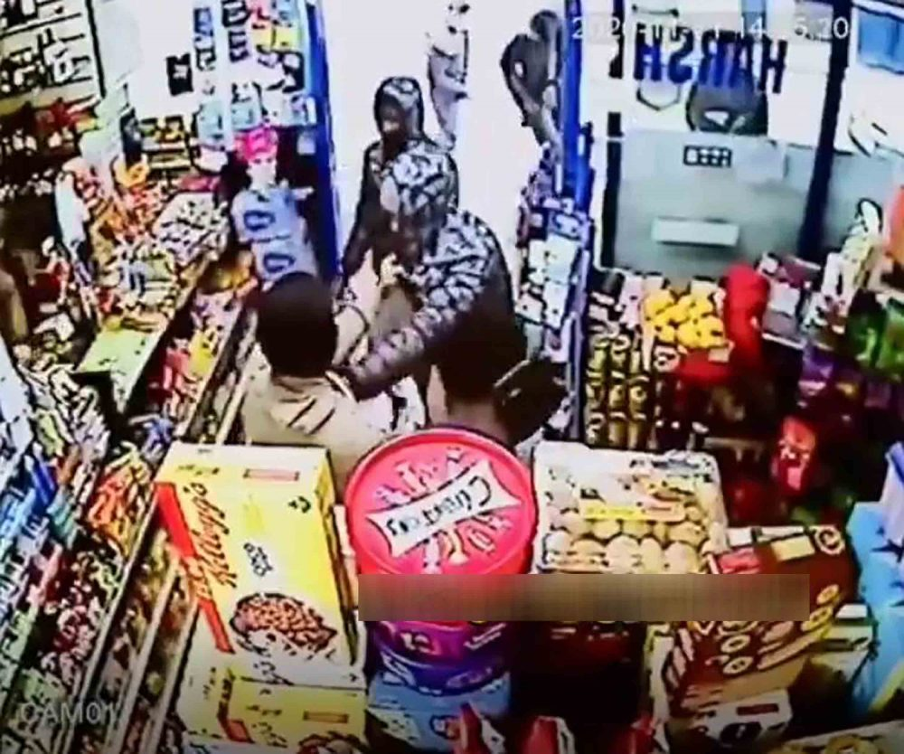The shopkeeper grappling with the boys - Crime News UK