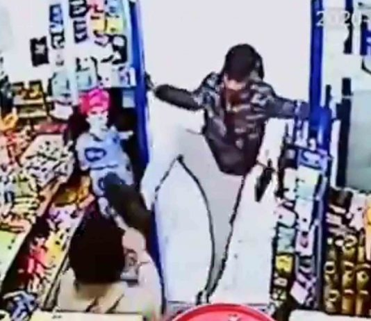 The shopkeeper is then attacked by the group of youths - Crime News UK