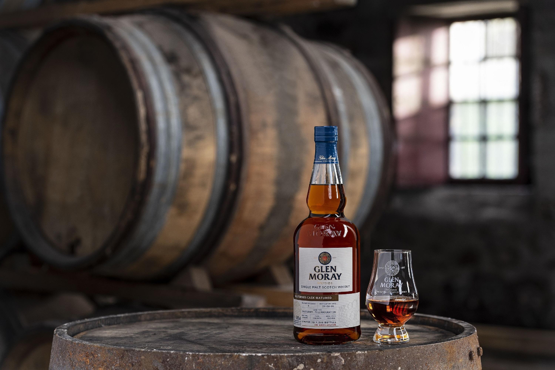 Glen Moray whisky bottle on barrel