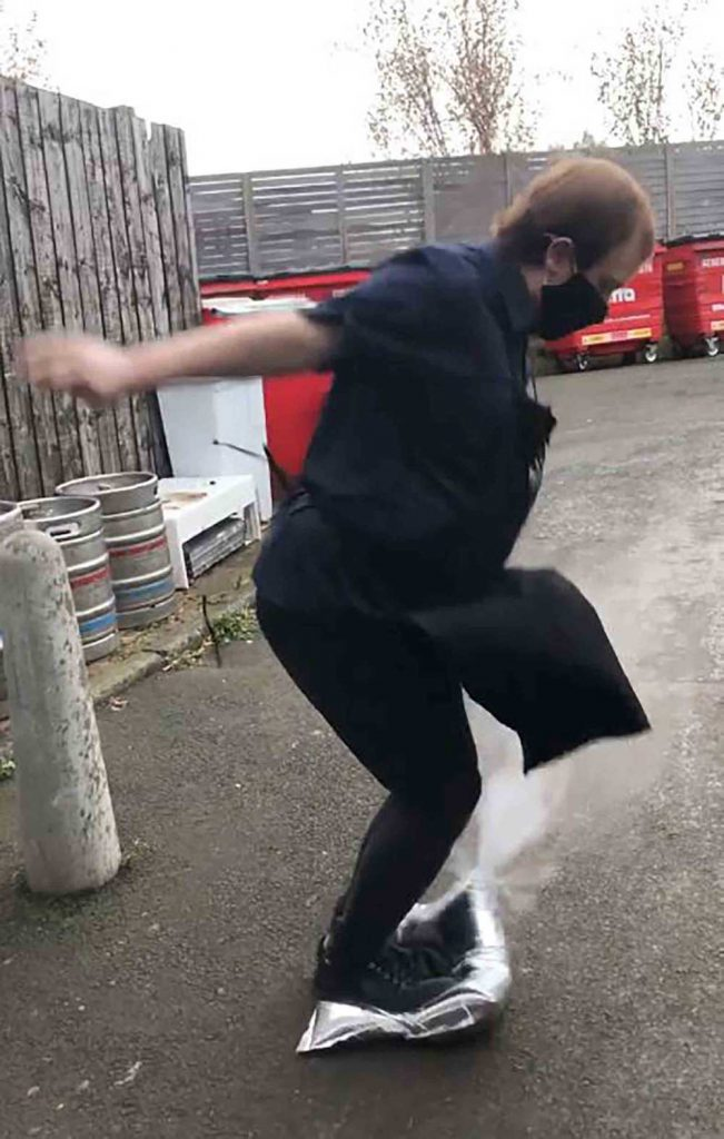 Scot's waiter jumps on bag of cleanign fluid to smash face on Bollard