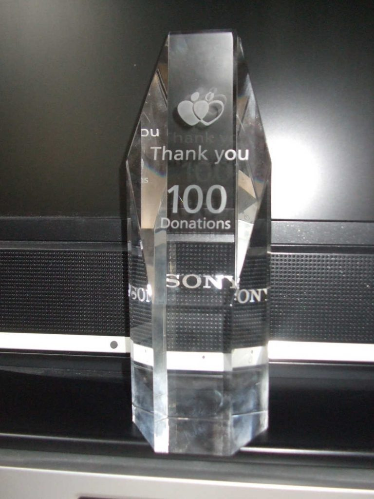 The trophy he was given as a thanks for donating 100 times
